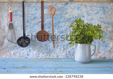 Italian Parsley and kitchen utensils, fee copy space - stock photo