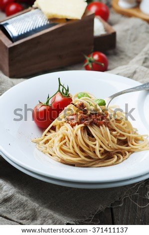 Italian pasta bolognese with meat and tomato, selective focus