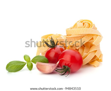 Italian pasta fettuccine nest  and cherry tomato isolated on white background - stock photo