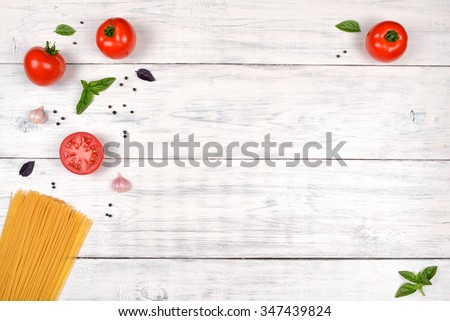 Italian pasta ingredients on white wooden table, top view, copy space - stock photo