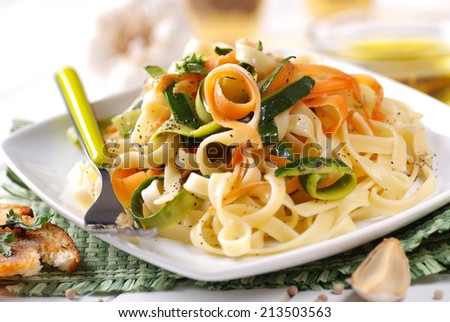 Italian pasta noodles with assorted vegetables in square dish