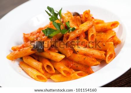Italian pasta on white plate - stock photo