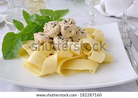 Italian pasta - Pappardelle with chicken fillet in a creamy sauce , sesame seeds