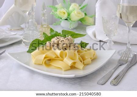 Italian pasta - Pappardelle with chicken fillet in a creamy sauce with sesame seeds - stock photo
