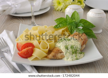 Italian pasta - Pappardelle with chicken in cream sauce and cherry tomatoes - stock photo