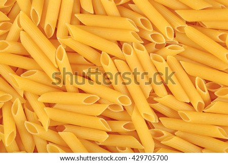 Italian pasta penne as background texture
