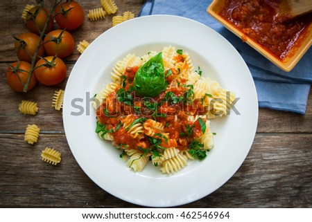 italian pasta radiatori with tomato sauce and parsley on plate