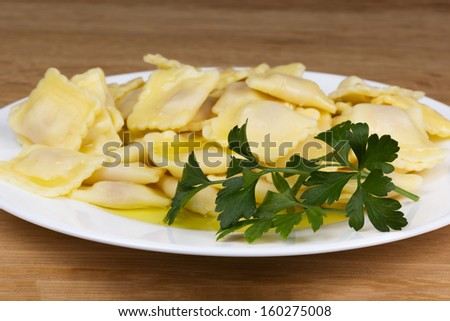 Italian pasta, ravioli with parsley and olive oil close up