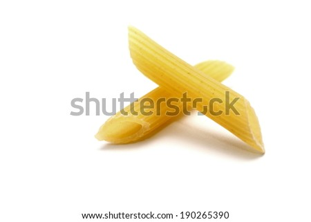 Italian pasta, row of penne rigate, isolated on white background - stock photo