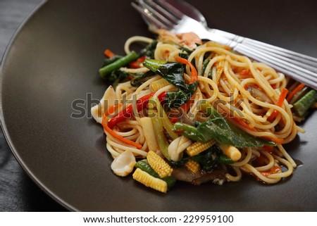 Italian pasta - spaghetti bolognese in plate, at restaurant - stock photo