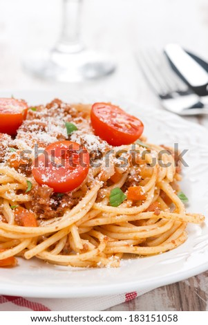 Italian pasta - spaghetti bolognese on a plate, close-up, vertical
