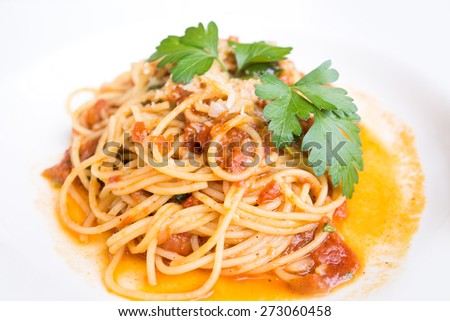 Italian pasta, Spaghetti Bolognese with basil on white plate - stock photo