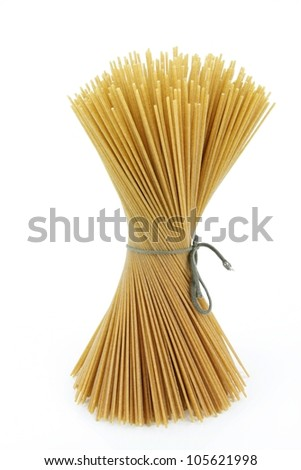 Italian pasta (spaghetti) whole grain. On a white background. - stock photo