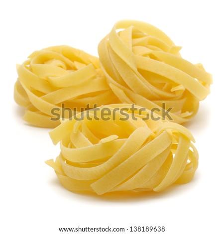 "Italian pasta ""tagliatelle"" isolated on white background - stock photo"