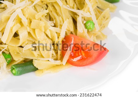 Italian pasta with basil and peas. Isolated on a white background.