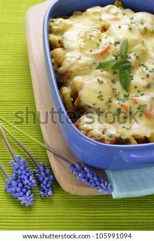 Italian pasta with cheese in baking dish. - stock photo