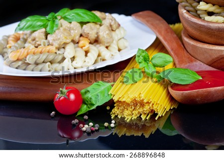 Italian pasta with cherry tomato and basil - stock photo