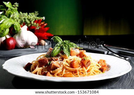 italian pasta with eggplant gray table green background - stock photo