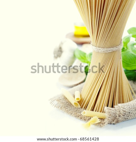 Italian Pasta with garlic, olive oil and basil - stock photo