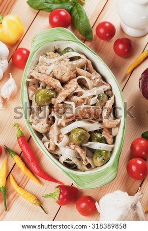 Italian pasta with grilled chicken meat, brussel sprouts and cauliflower - stock photo