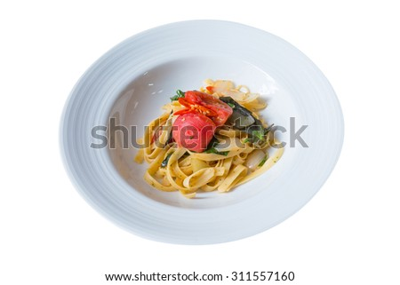 Italian pasta with thyme, tomato, basil, onion and chili pepper Thai style on isolated white background - stock photo