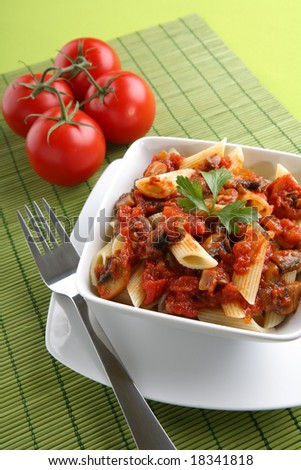 Italian pasta with tomato sauce and parmesan. - stock photo