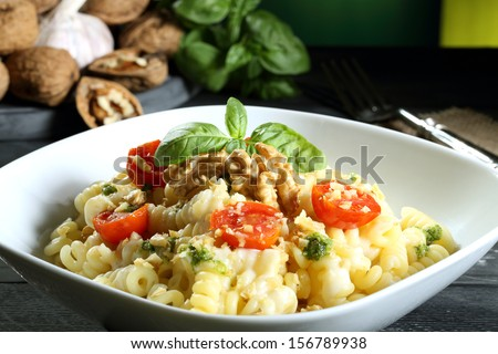italian pasta with vegetables green background - stock photo