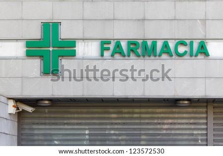 Italian Pharmacy Sign and Shop - stock photo