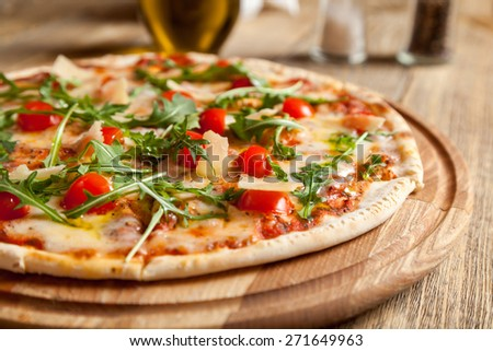 "Italian pizza ""Caprese"" lies on beautiful wooden table."