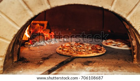 italian pizza is cooked in a woodfired oven - Wood Fired Oven