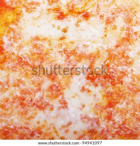 Italian Pizza Margherita (Margarita) with tomato and Mozzarella cheese - useful as a background - stock photo