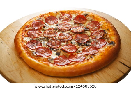 Italian pizza on a wooden platter - stock photo