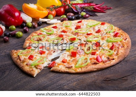 Italian pizza on wood table with ingredients
