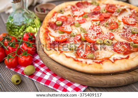 Italian Pizza with  ham olives and cherry tomatoes