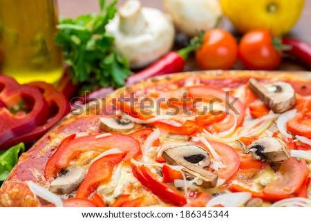 Italian pizza with mushrooms and onion - stock photo