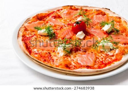 Italian pizza with salmon - stock photo