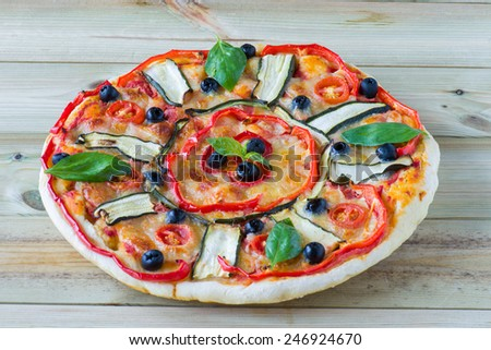italian pizza with vegetables in wooden table - stock photo