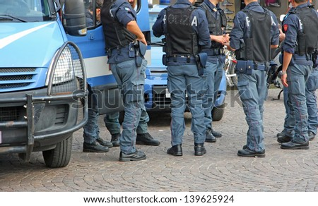 Italian policemen with bulletproof and armored jacket during a riot in the city - stock photo