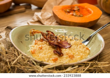 Italian risotto with grilled mushrooms and bacon. Shallow dof. - stock photo