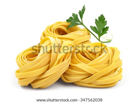 Italian rolled fresh fettuccine pasta with flour and parsley isolated on white background.  - stock photo