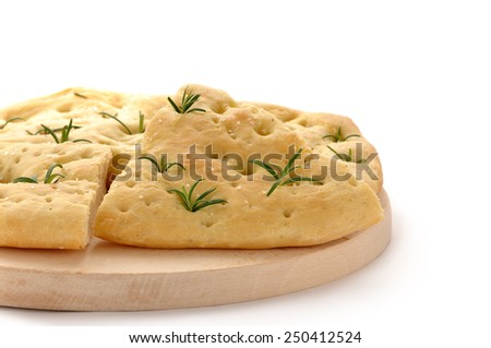Italian rosemary Focaccia bread on a wooden board. - stock photo