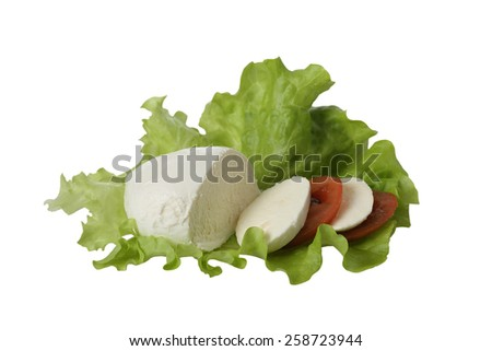 Italian salad - Mozzarella cheese with dark red tomato slices on green lettuce leaf isolated on white background - stock photo