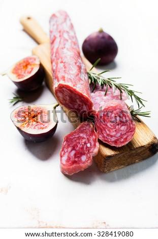 Italian salami on wooden cutting Board - stock photo