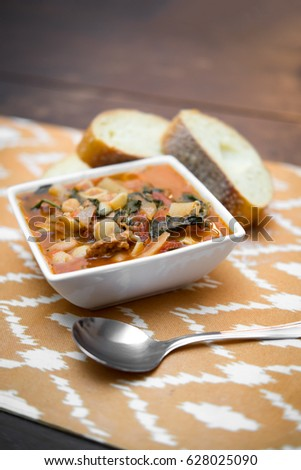 Italian sausage navy bean soup with tomatoes and french bread