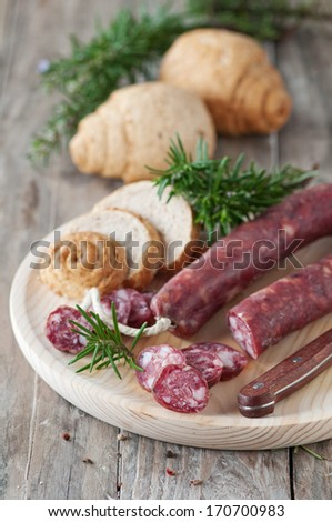 Italian sausage with homemade bread and rosemary, selective focus