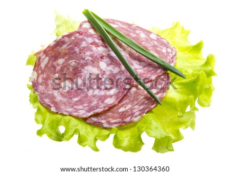 Italian sausages with salad leaves - stock photo