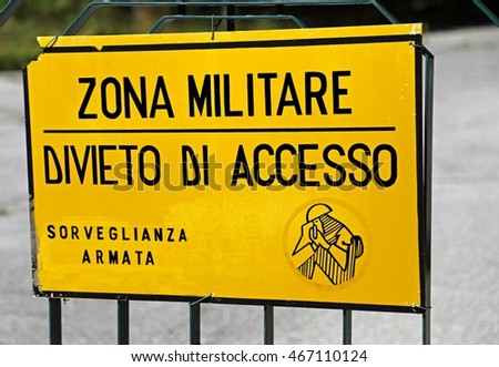 Italian sign of a military area with written that means military zone ban on armed surveillance access