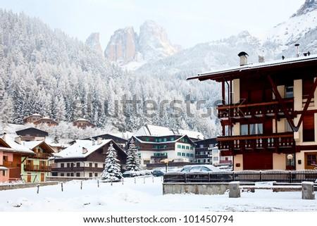 Italian ski resort with Dolomites in background - stock photo