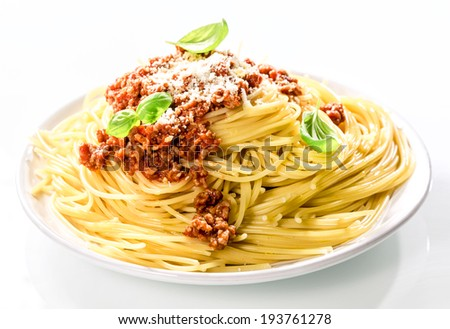 Italian spaghetti Bolognaise topped with a savory tomato based beef sauce with grated parmesan cheese and fresh basil for a healthy Mediterranean diet - stock photo
