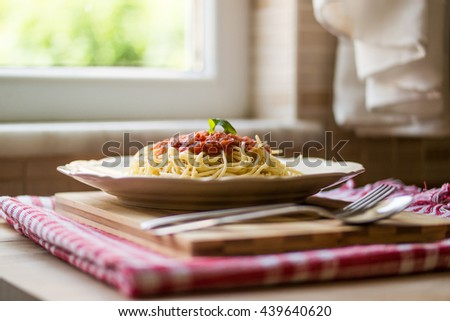 Italian Spaghetti bolognese served in the kitchen  - stock photo